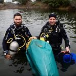 2 divers using a lift bag on the surface